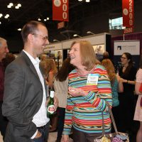 Rosemary shares a laugh with Adrian Norman, Vice President of Marketing and New Products at Simon & Schuster.