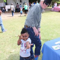 2018-Alabama-Book-Festival-IMD_4848-Caption-Batman-showing-off-his-Superman-socks-poses-with-little-friend